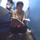 An Eastern-European woman desperately sits down on a toilet and takes a shit with sloppy, wet gurgling sounds. She reads a magazine while trying to push out more. Presented in 720P HD, however, video quality is somewhat dark and grainy. About 10 minutes.